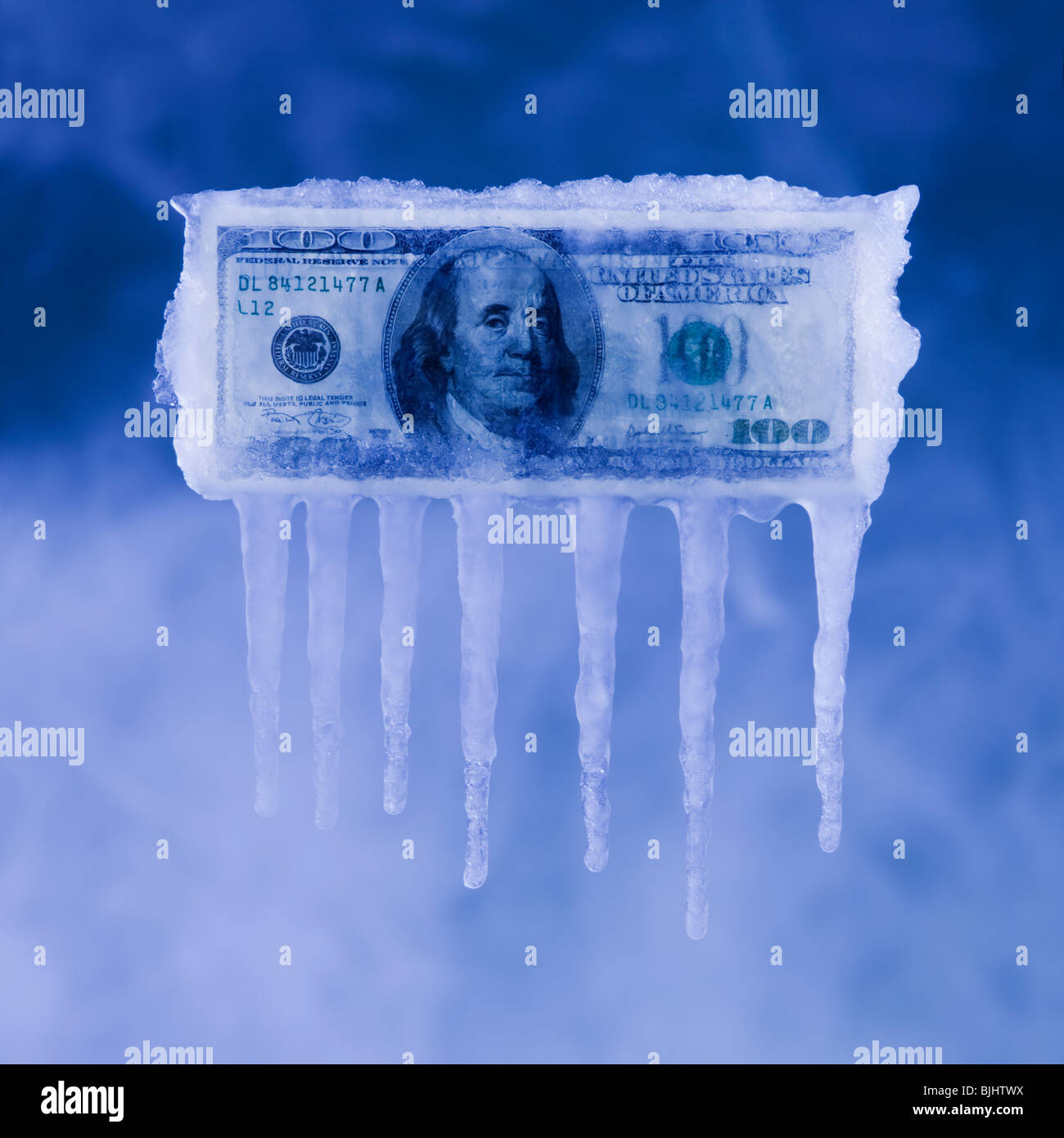 Money covered in ice - Stock Image