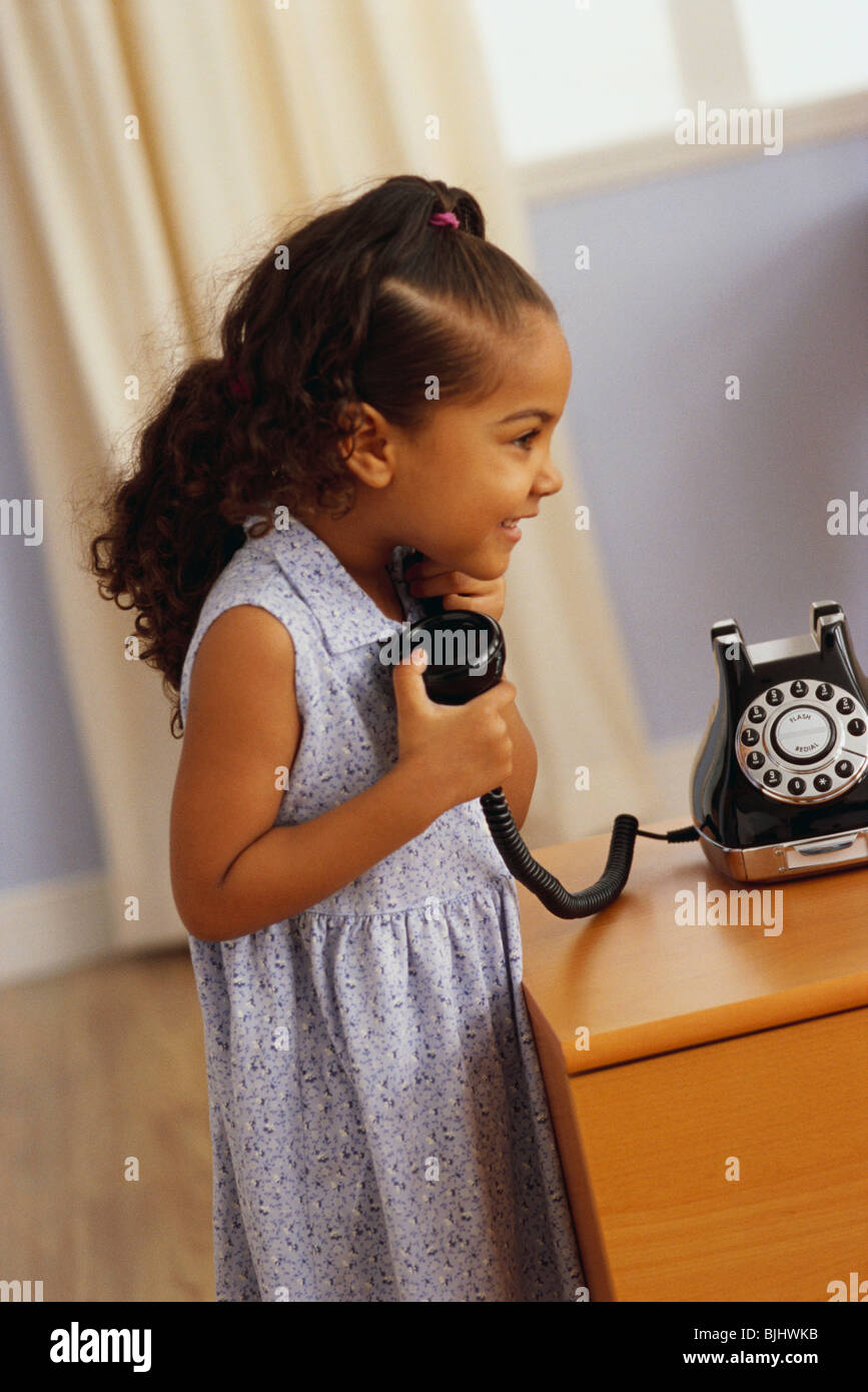 Young girl talking on telephone - Stock Image