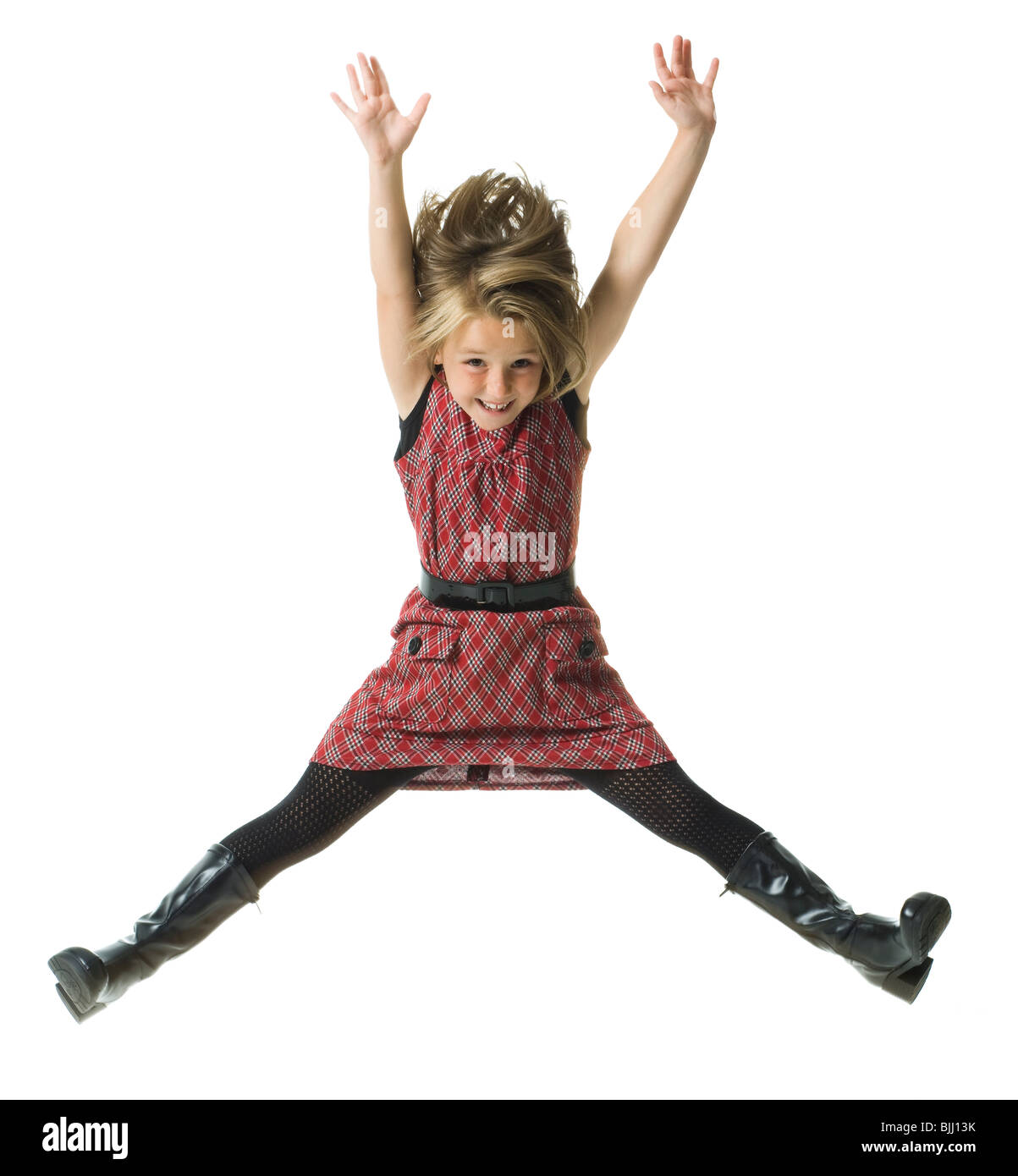 Girl smiling and leaping - Stock Image