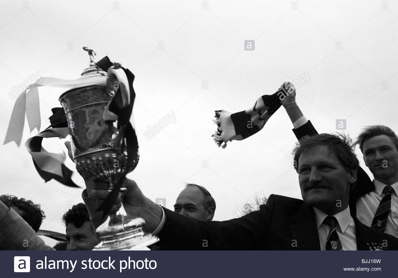 16/05/87 St Mirren assistant manager Jimmy Bone celebrates with the Scottish Cup on the team bus. - Stock Image