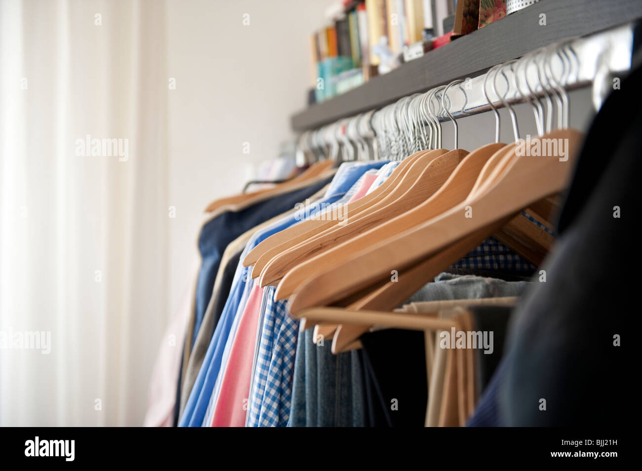 a mess of dress in a confused wardrobe - Stock Image