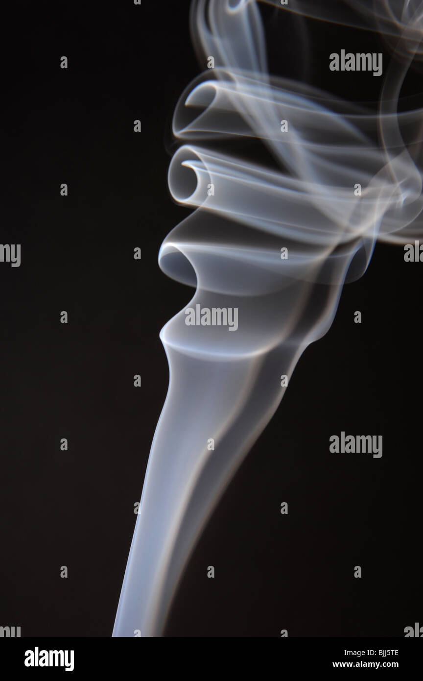 Curls and whirls of smoke backlit - Stock Image