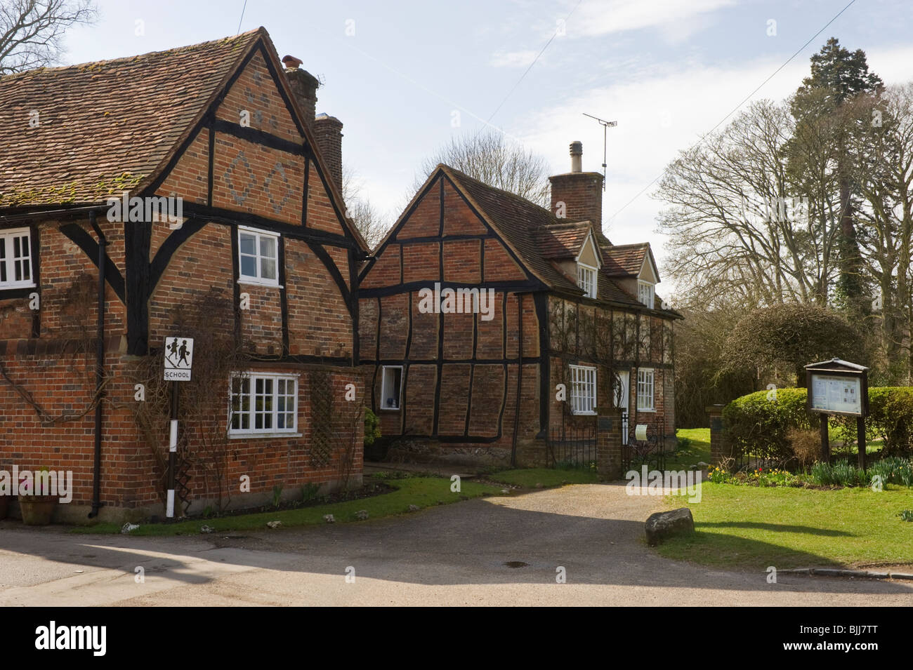 Traditional period red brick built timbered cottages in Turville village Buckinghamshire UK - Stock Image