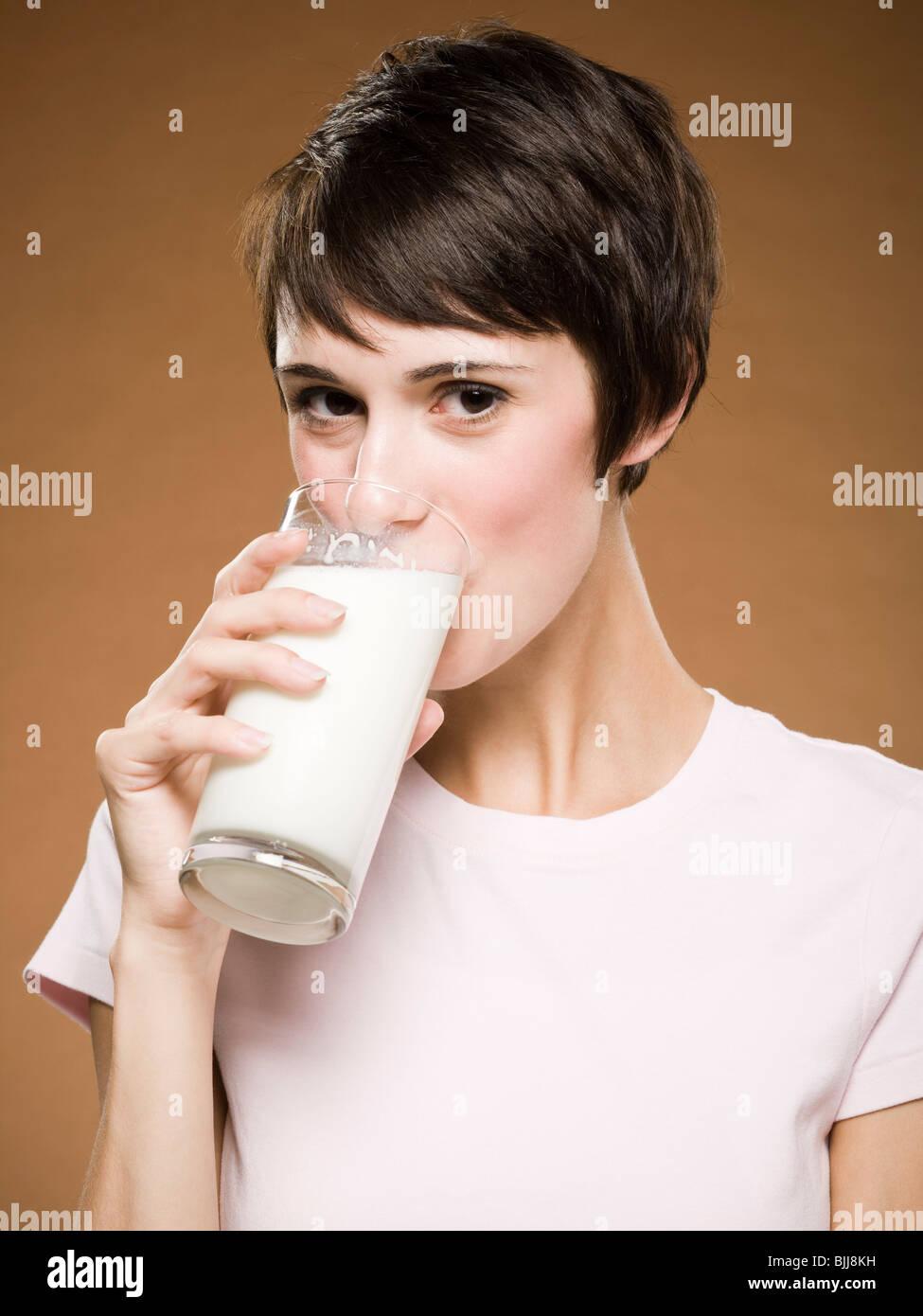 Woman drinking glass of milk Stock Photo