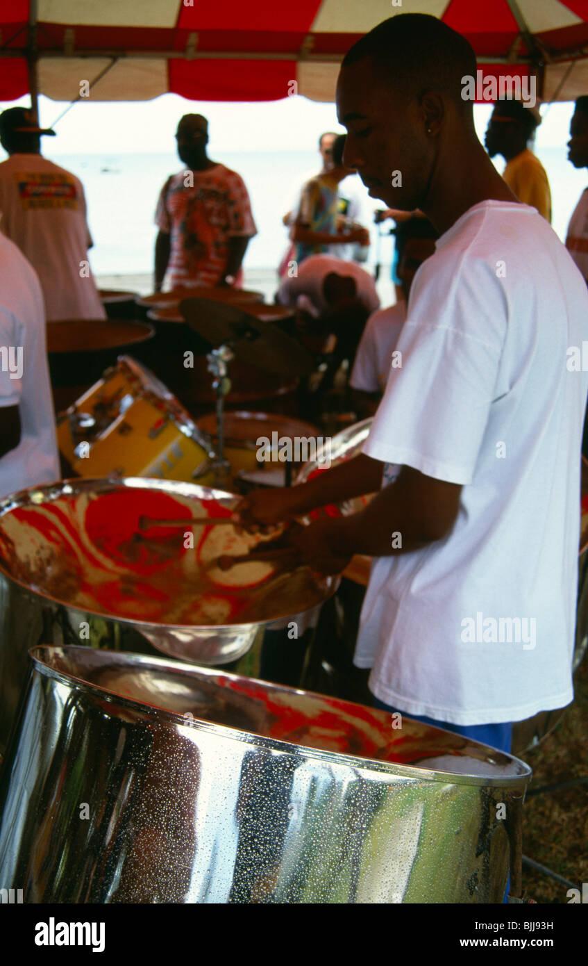 WEST INDIES, Caribbean, Tobago, Music Katzenjammer Steel Band drummer playing drums or pans. - Stock Image