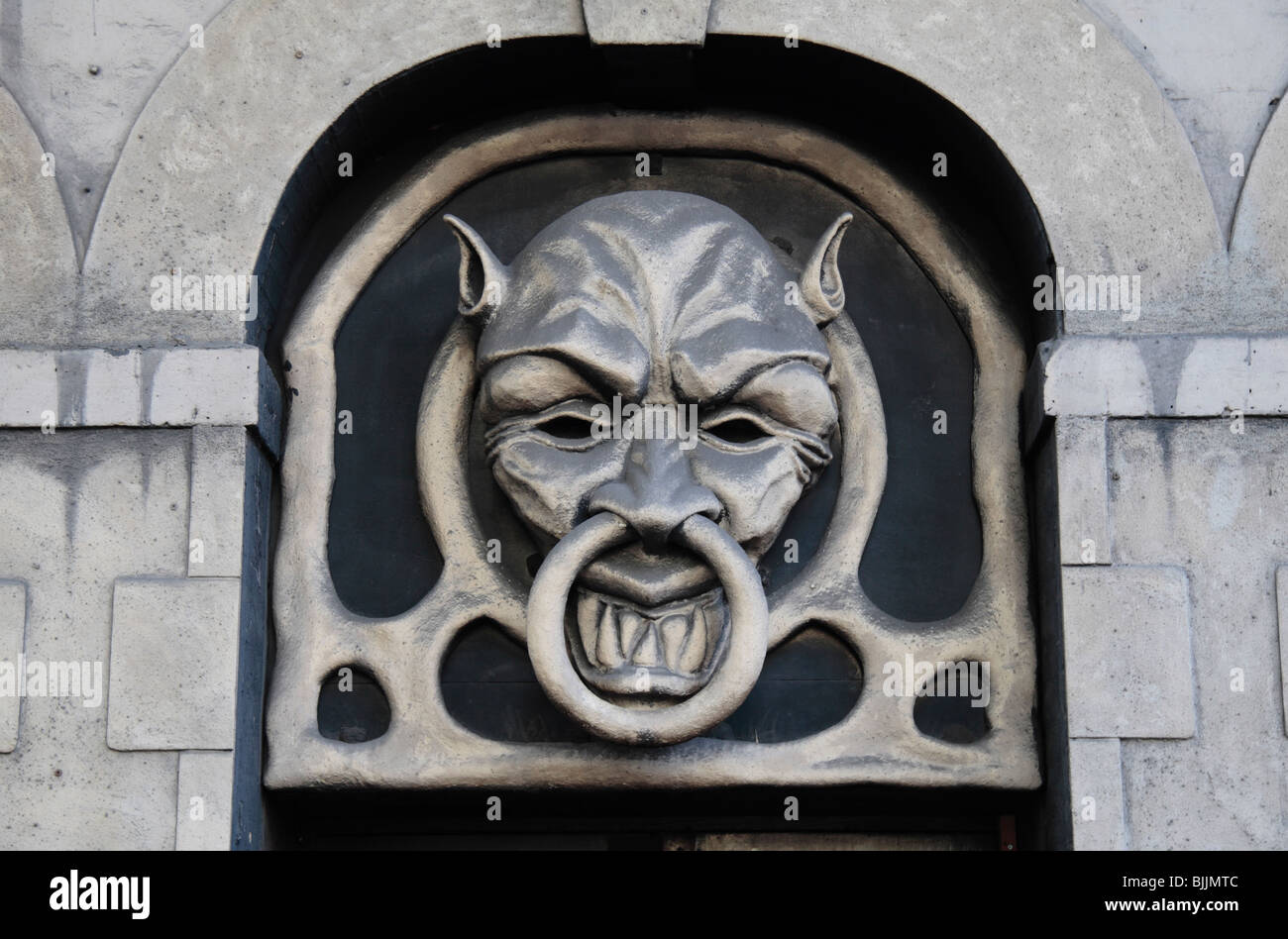Spooky door knocker sign above the entrance to London Dungeon London UK. & Spooky door knocker sign above the entrance to London Dungeon Stock ...