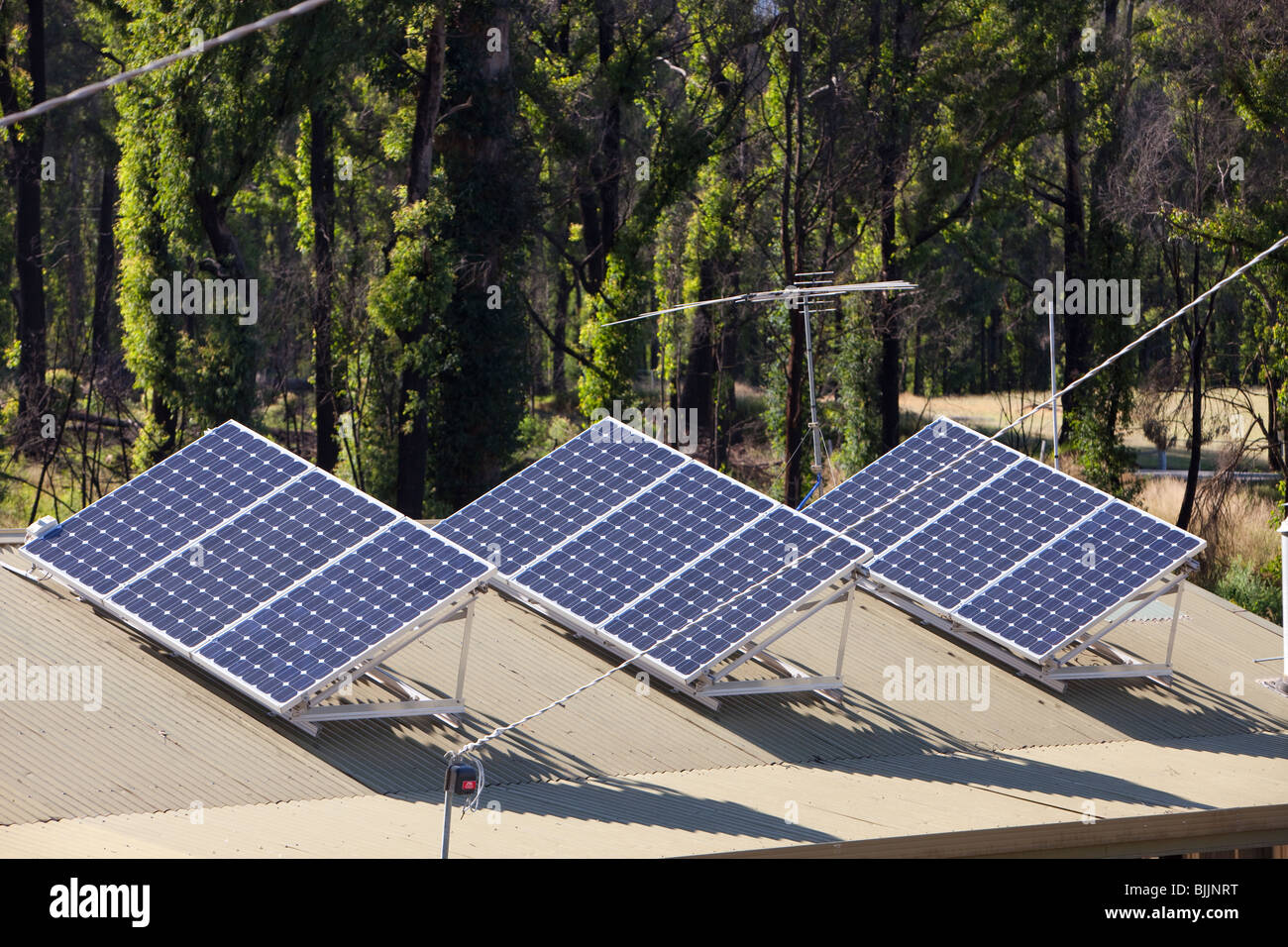 Solar panels on a house roof in Kinglake, Victoria, Australia. - Stock Image