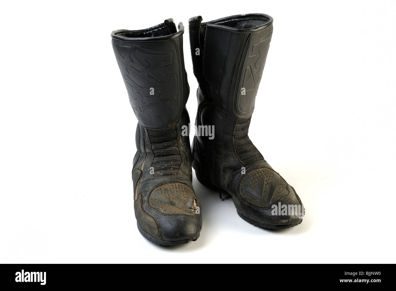 Well worn set of motorcycle boots - Stock Image
