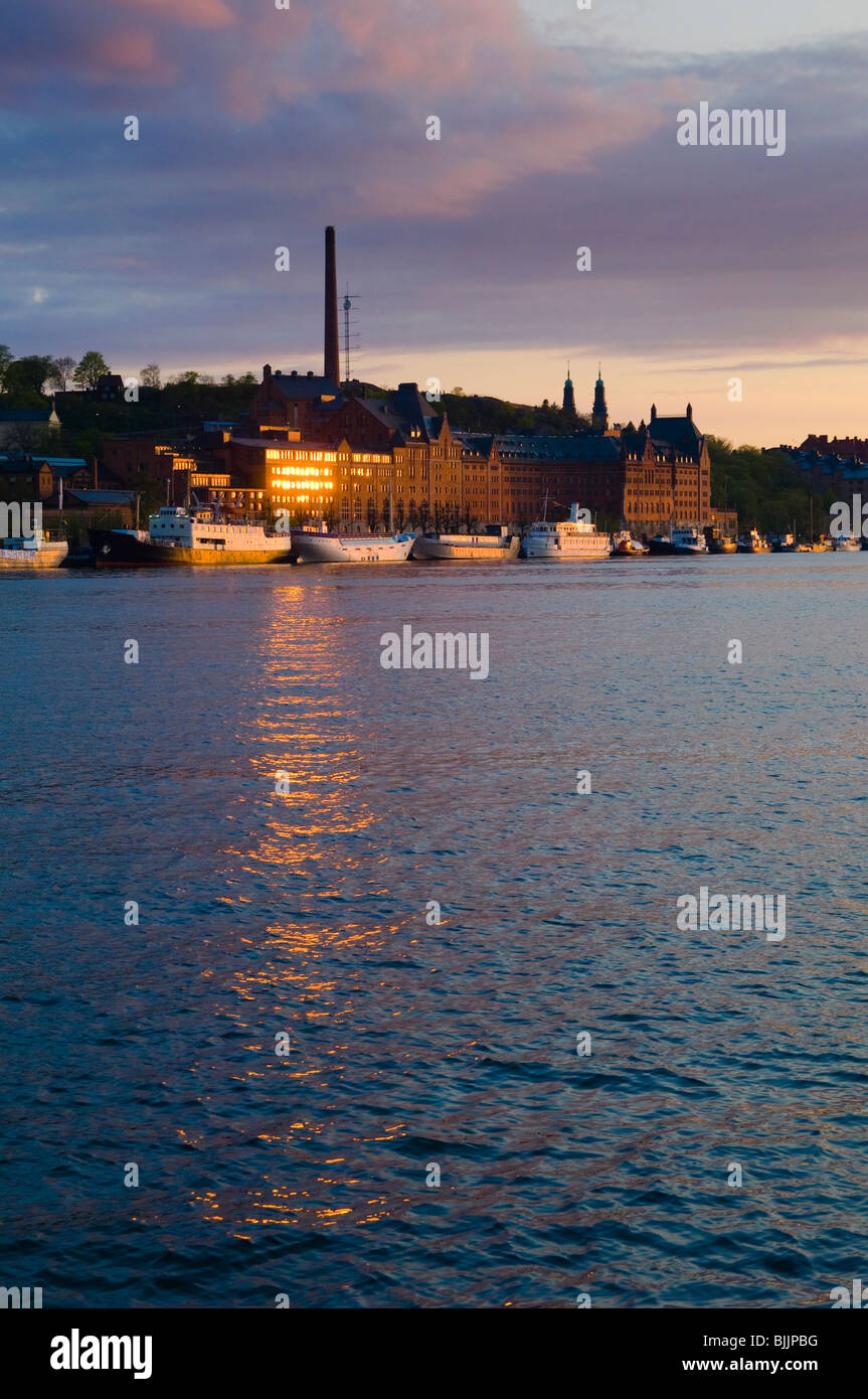 Evening light on the Riddarfjärden waterway and former München Brewery, Stockholm, Sweden - Stock Image