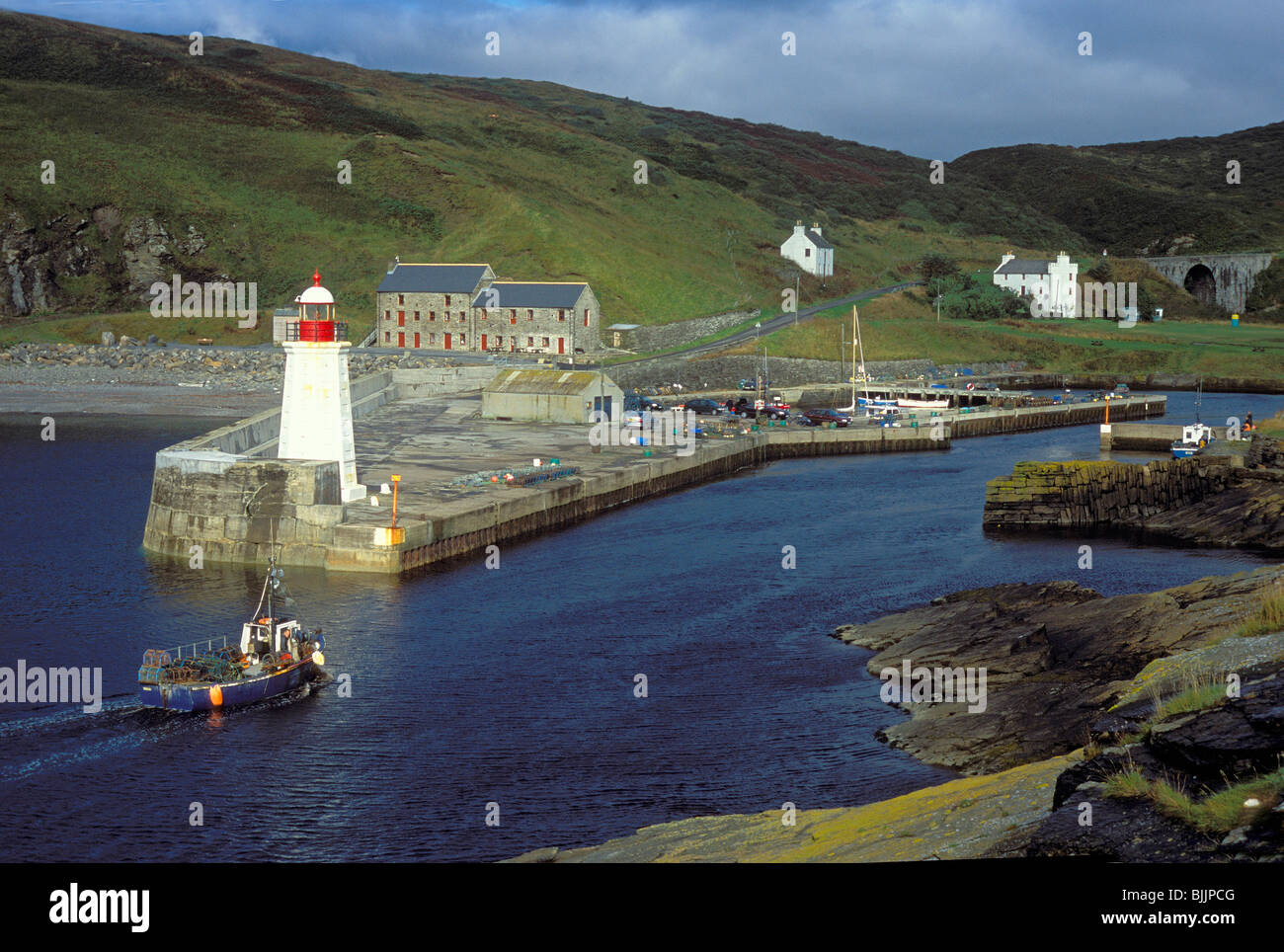 View of Lybster Harbour Caithness with returning fishing vessel - Stock Image