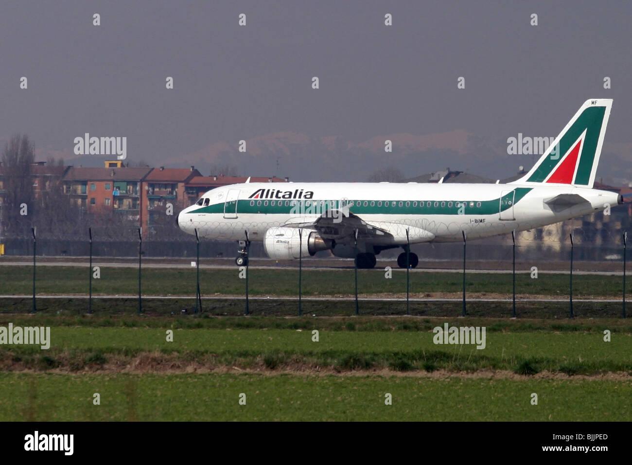 Italy, Milan, Linate Airport, Alitalia passenger jet at takeoff - Stock Image