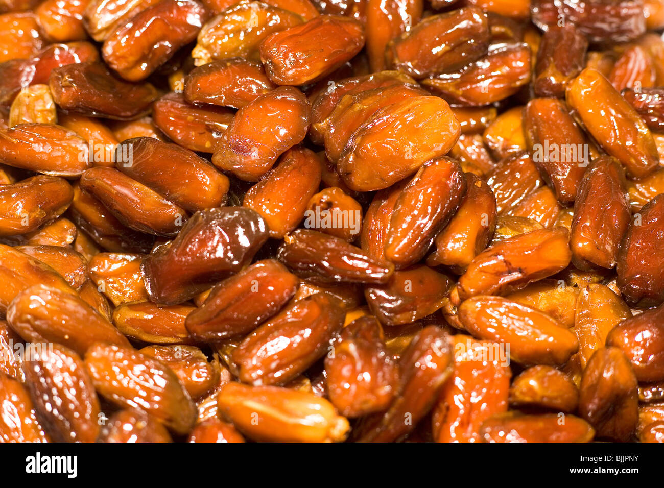 Dates at a stall in the municipal market (Mercado des Lavradores) in Madeira, Portugal. - Stock Image
