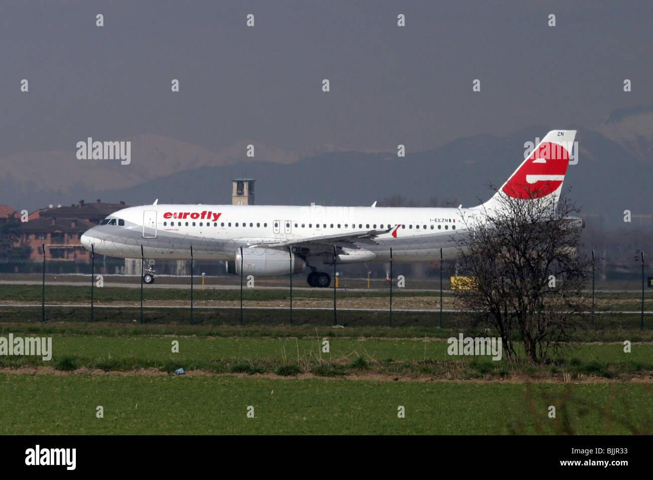 Italy, Milan, Linate Airport, Eurofly passenger jet at take off - Stock Image