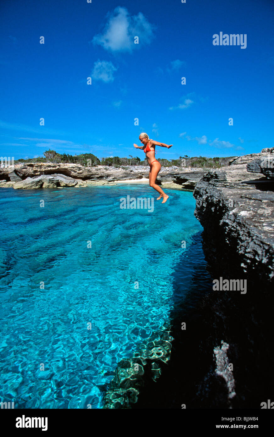 Turks Caicos Islands Providenciales Woman Jumping Off Rock Wall