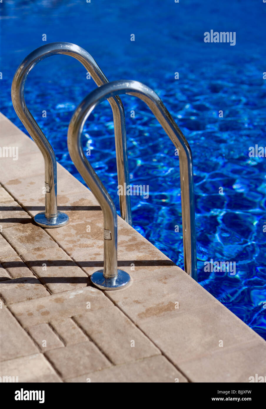 Swimming pool and ladder railings - Stock Image