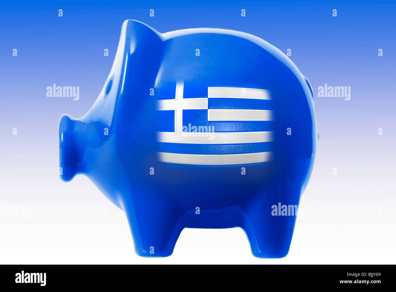 Piggy bank with a Greek flag and euro coin, symbolic for Greece's saving policy - Stock Image