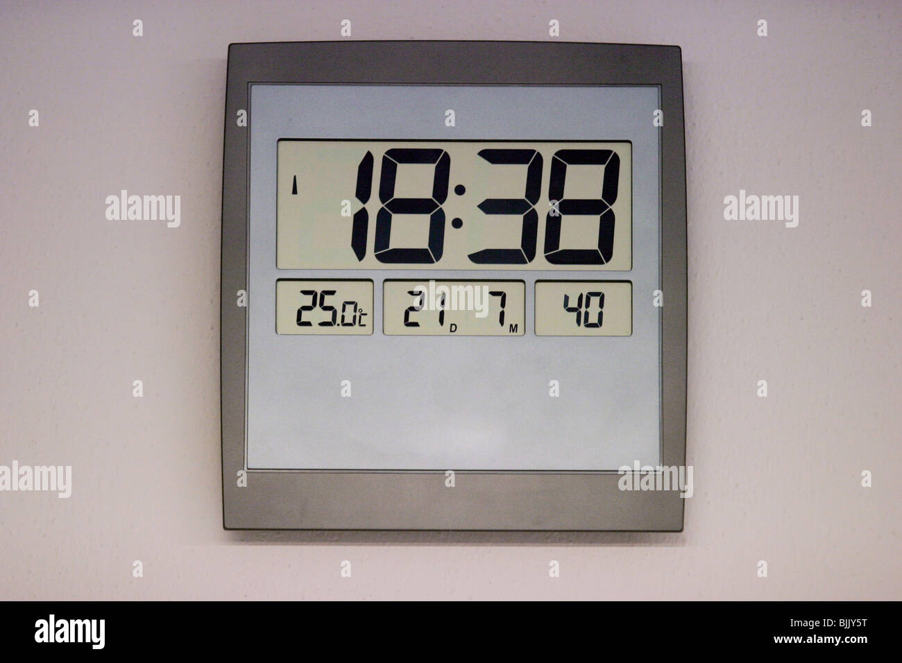 Digital clock with time, date and temperature read out - Stock Image