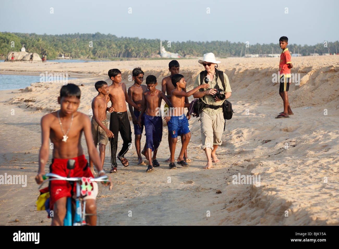 Photographer being accompanied by Indian children, Poovar River, Puvar, Kerala, South India, India, Asia Stock Photo