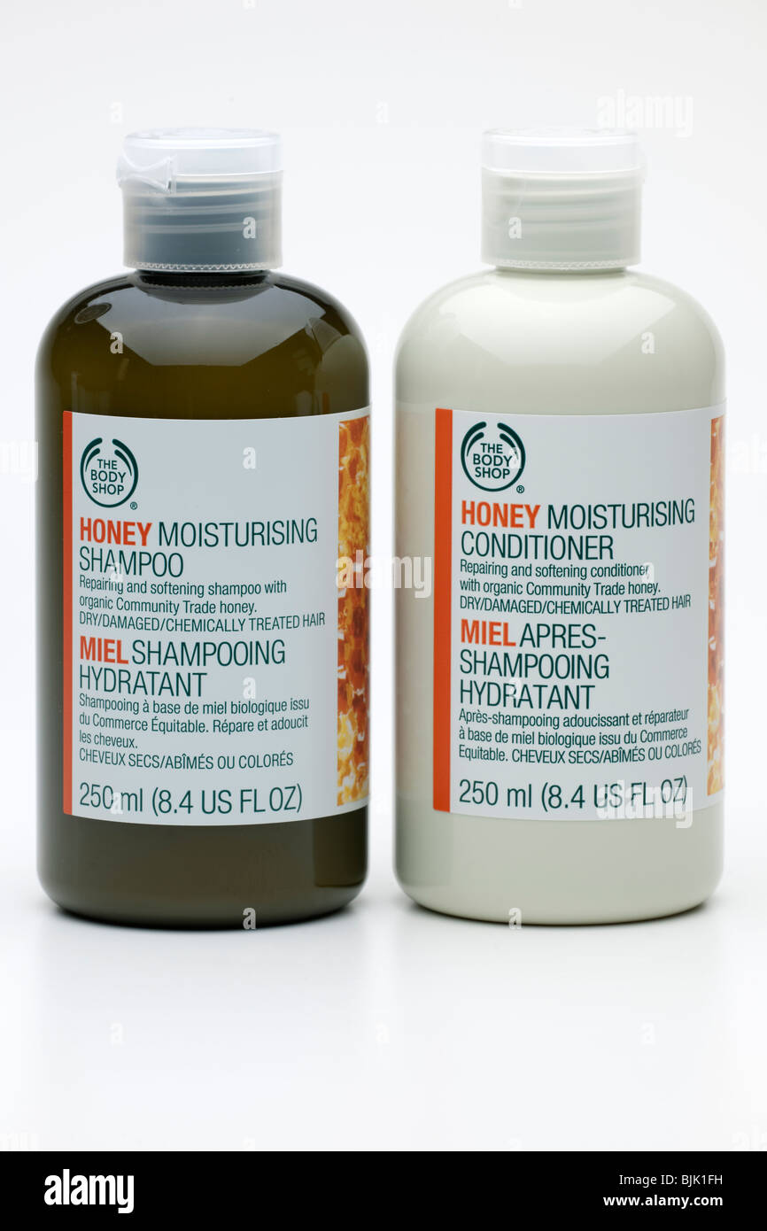 Two bottles of The Body Shop Honey moisturising shampoo and conditioner - Stock Image