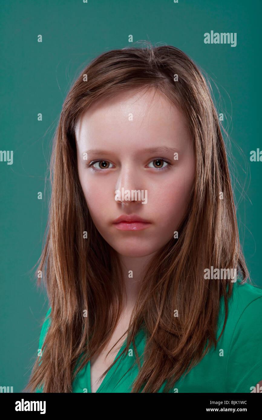 studio portrait of a pretty, eleven years old girl - Stock Image