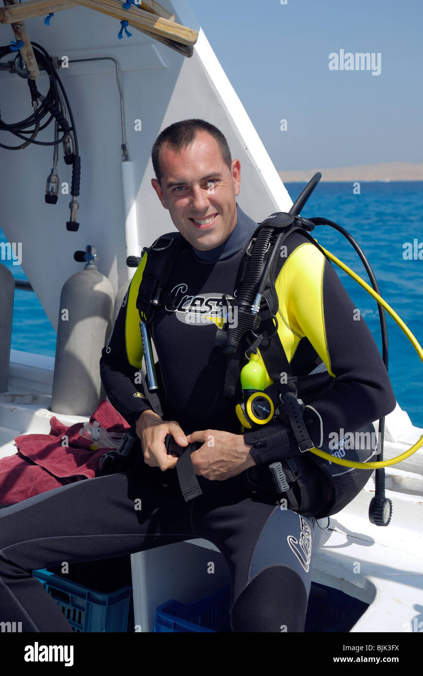 Diver gearing up before going to dive - Stock Image