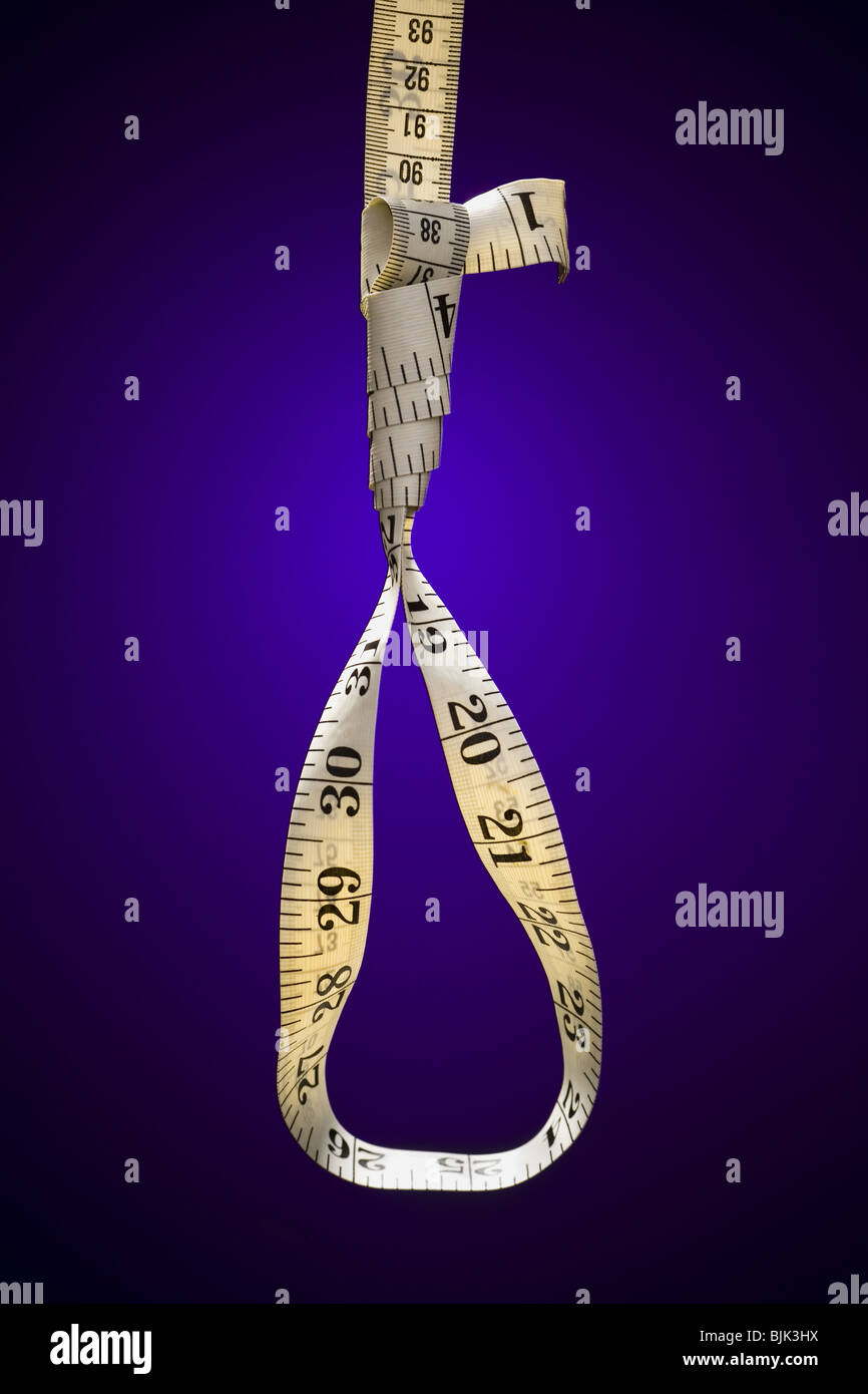 Tape measure forming noose - Stock Image