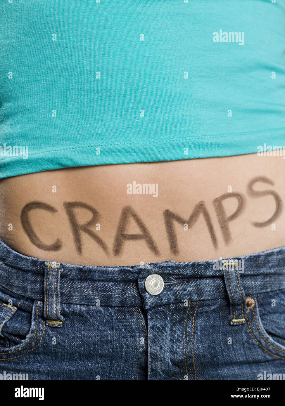 Female Abdomen with CRAMPS written on it - Stock Image