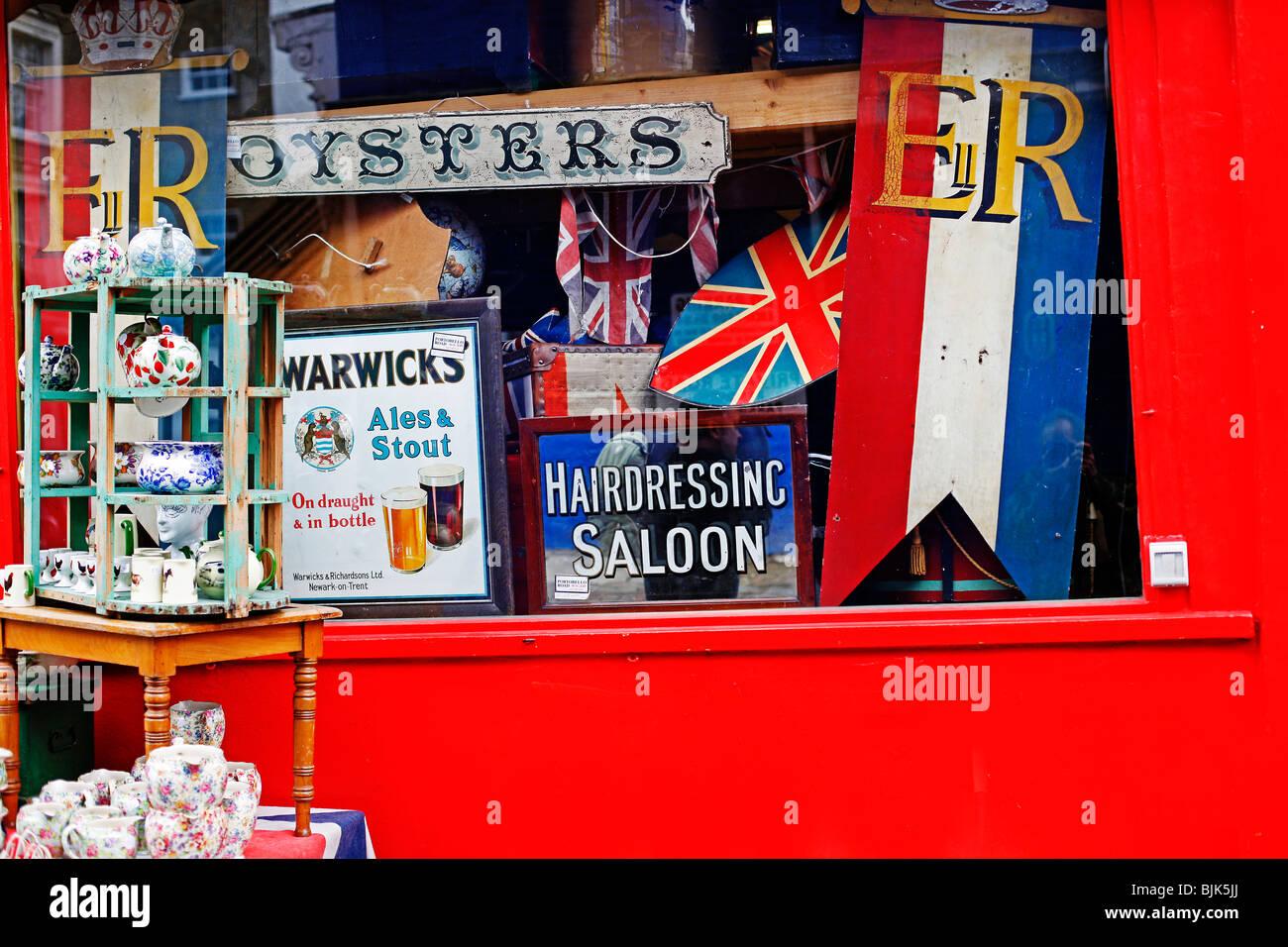 A colorful or colorful antique or junk  shop in Portobello Road, London - Stock Image