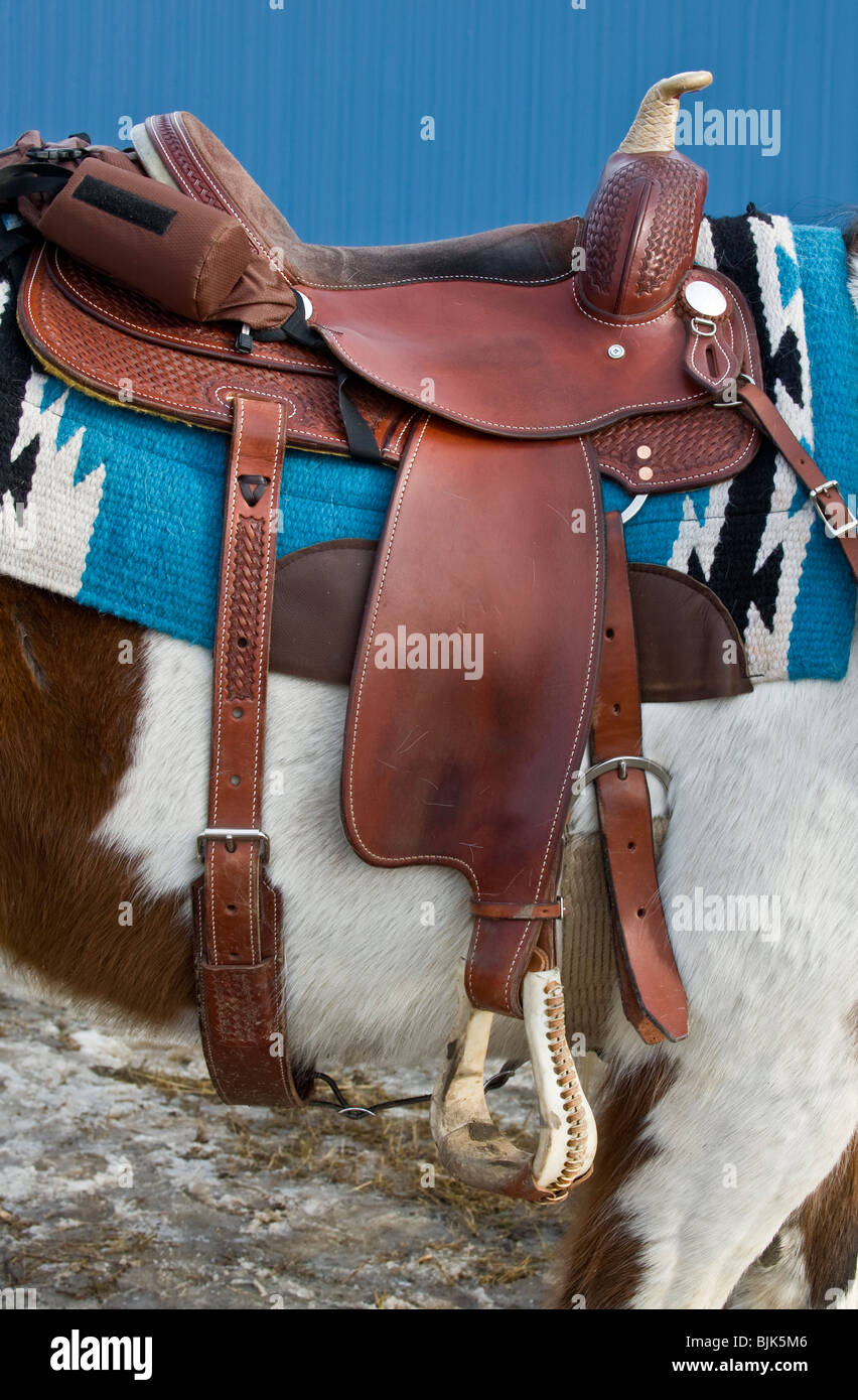 An image of a western style leather saddle. Stock Photo