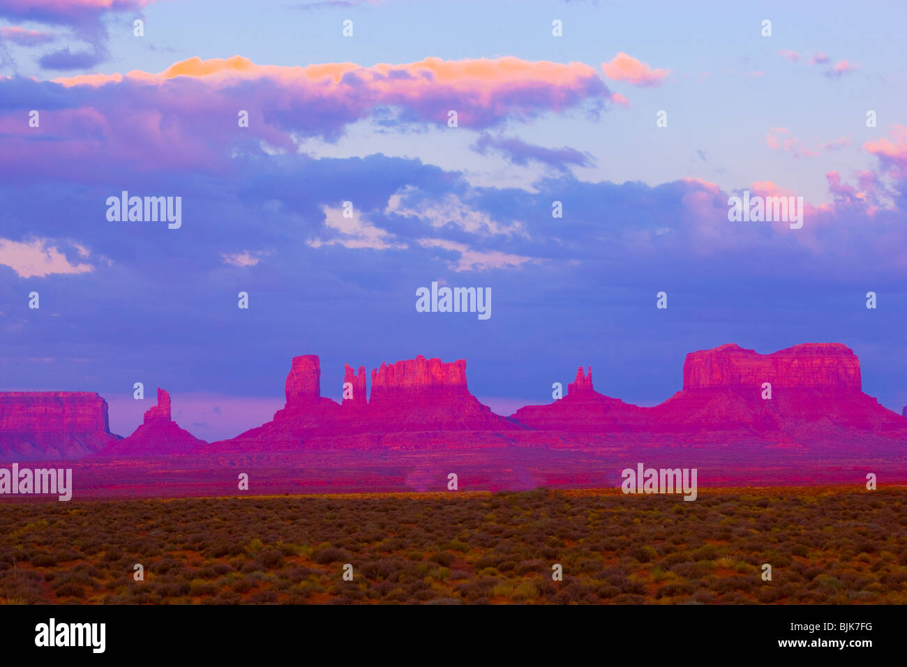 Monument Valley Tribal Park, Utah, The Bear, Stagecoach and other pinnacles, Sunrise - Stock Image