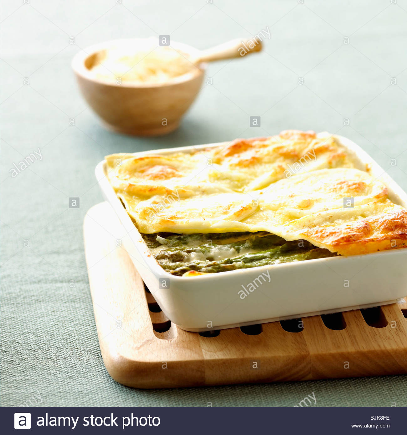 asparagus lasagne in a baking dish on a trivet stock photo 28697970
