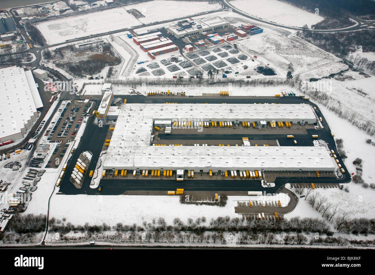 Aerial view, snow, DHL vehicle fleet, Hervest, Dorsten, Ruhrgebiet area, North Rhine-Westphalia, Germany, Europe Stock Photo