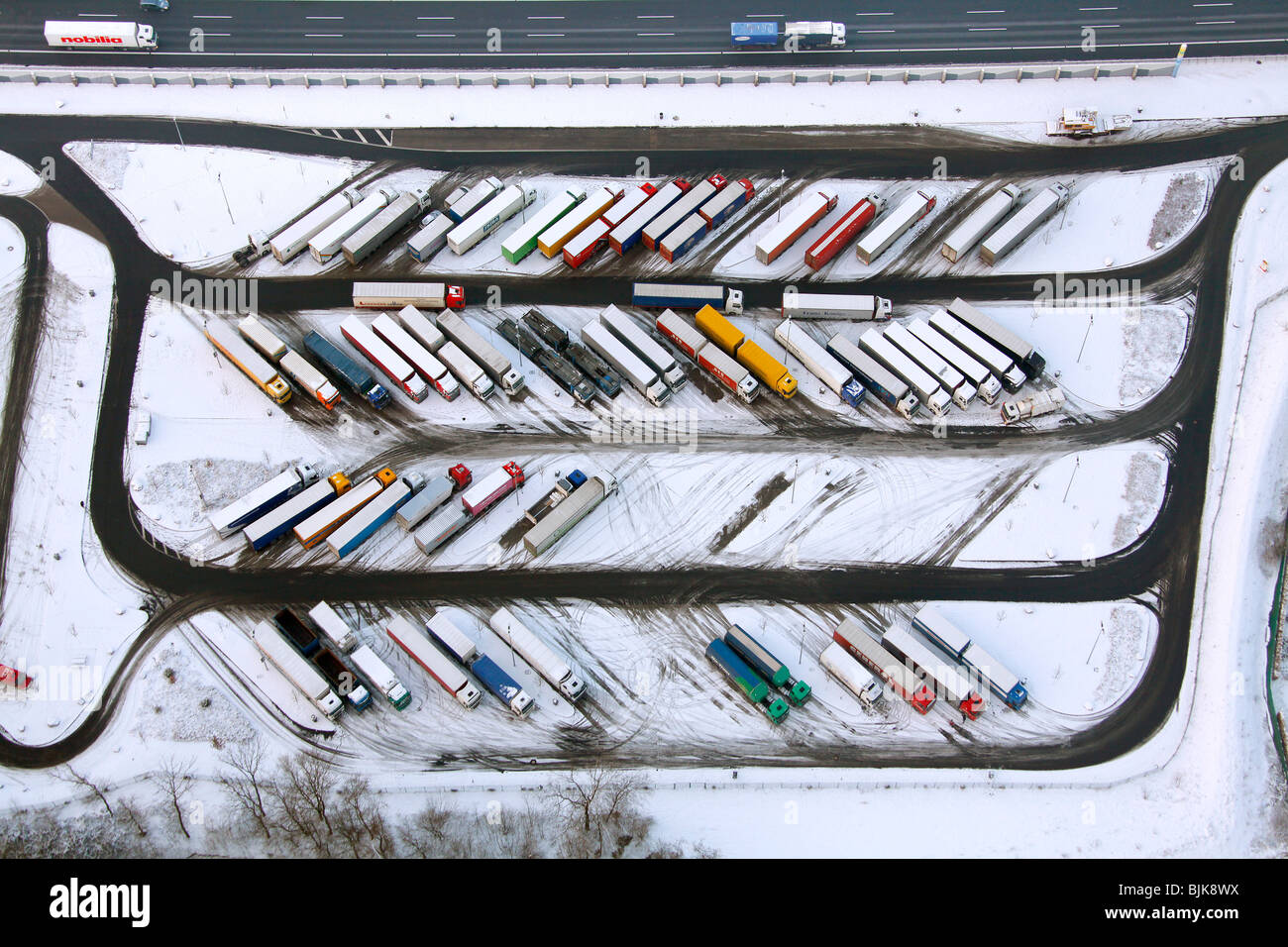 Aerial photo, Rhynern, A2 Autobahn, highway petrol station and rest stop, snow-covered truck parking area, Hamm, Stock Photo