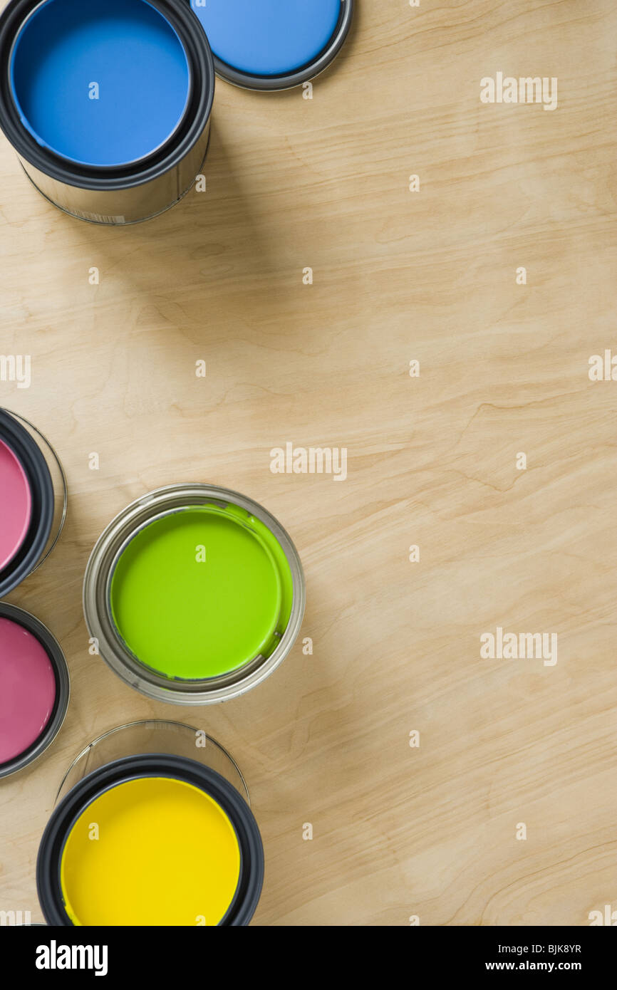 Overhead view of paint cans and stir stick - Stock Image