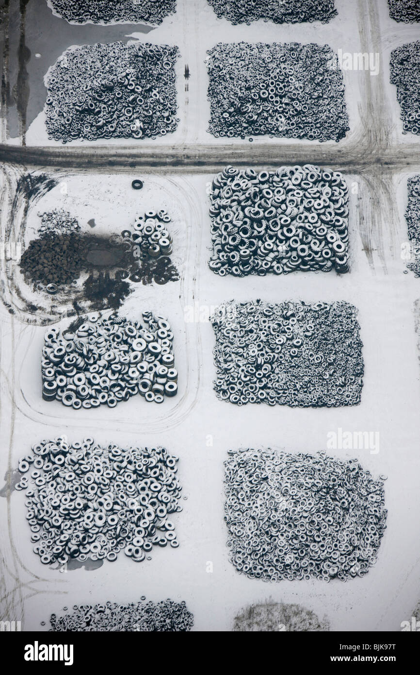 Aerial view, used tires storage, scrap tire recycling, snow, winter, Hervest, Dorsten, Ruhrgebiet area, North Rhine - Stock Image