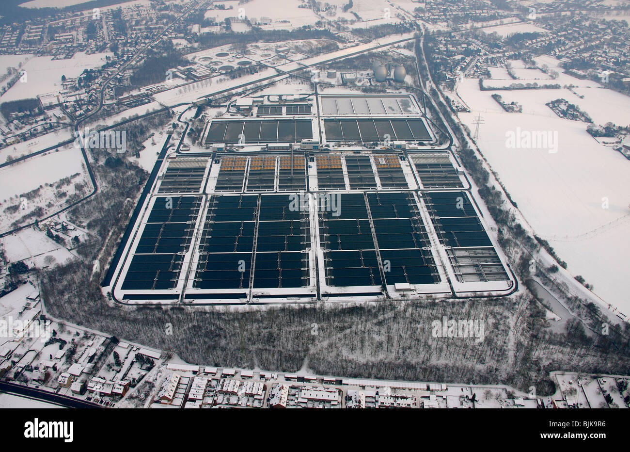 Aerial view, Emscher sewage treatment plant, Emscher river, Emscher course, Dinslaken, winter, snow, North Rhine - Stock Image