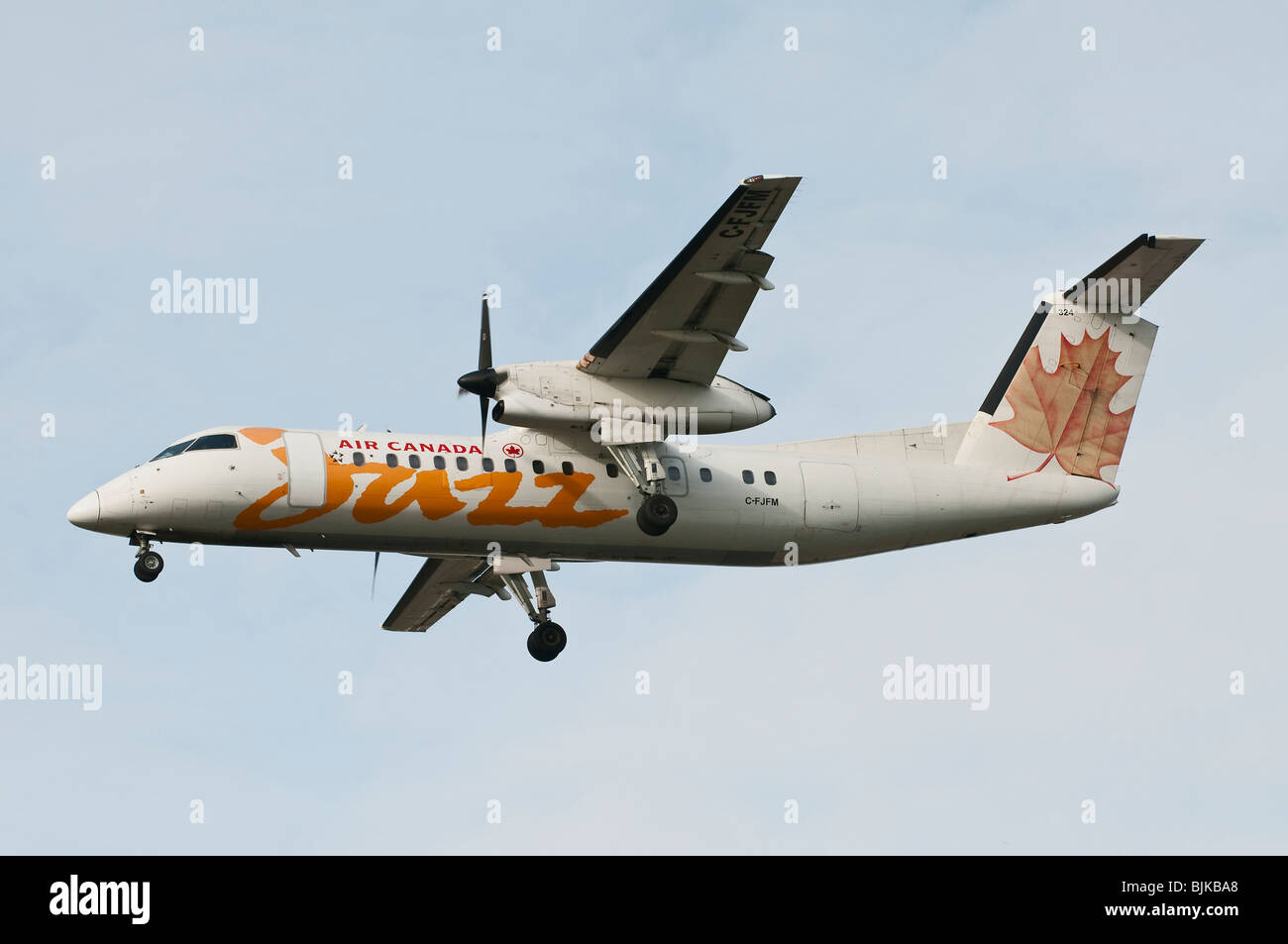 Air Canada Jazz Dash-8 turboprop airplane on final approach for landing - Stock Image