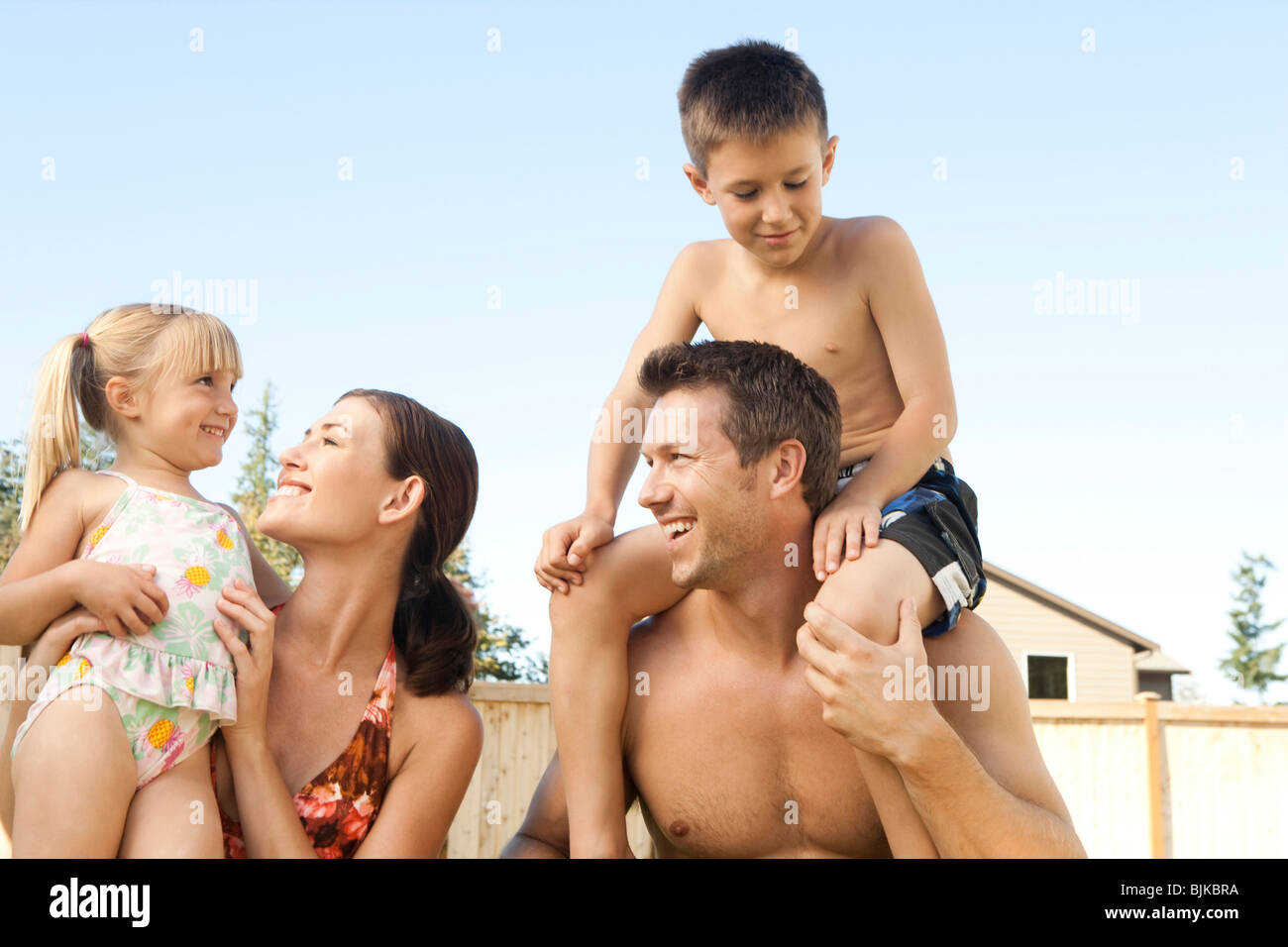 Family posing outdoors - Stock Image