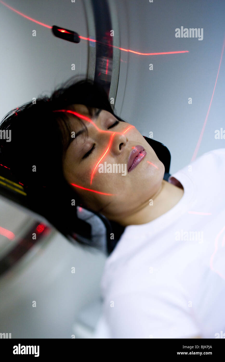 Headshot of woman entering MRI machine - Stock Image
