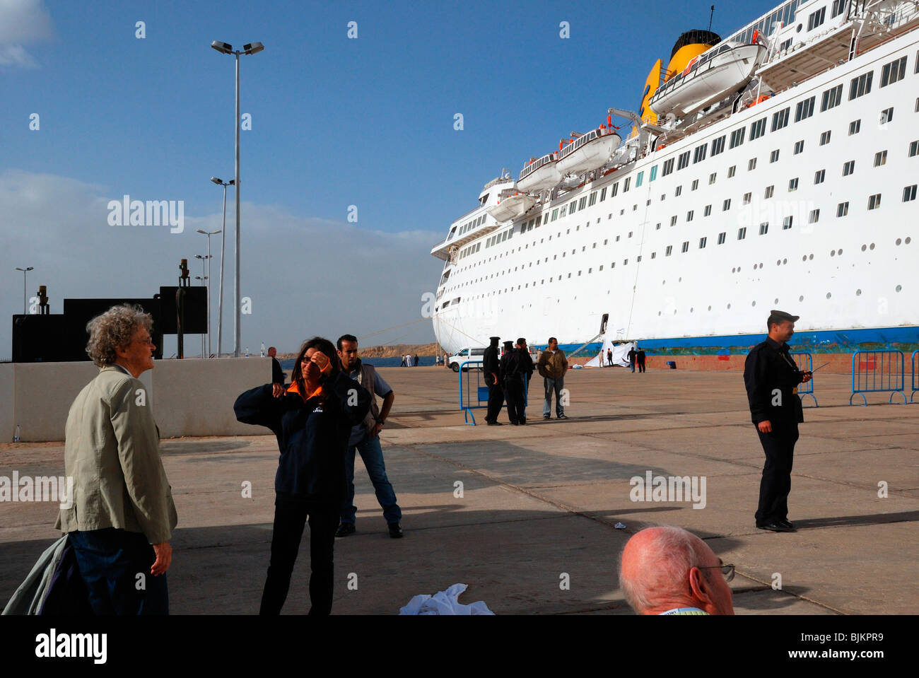 Listing COSTA EUROPA cruise ship after crashing into the quay, passengers and staff of Costa Cruises, security staff, Stock Photo