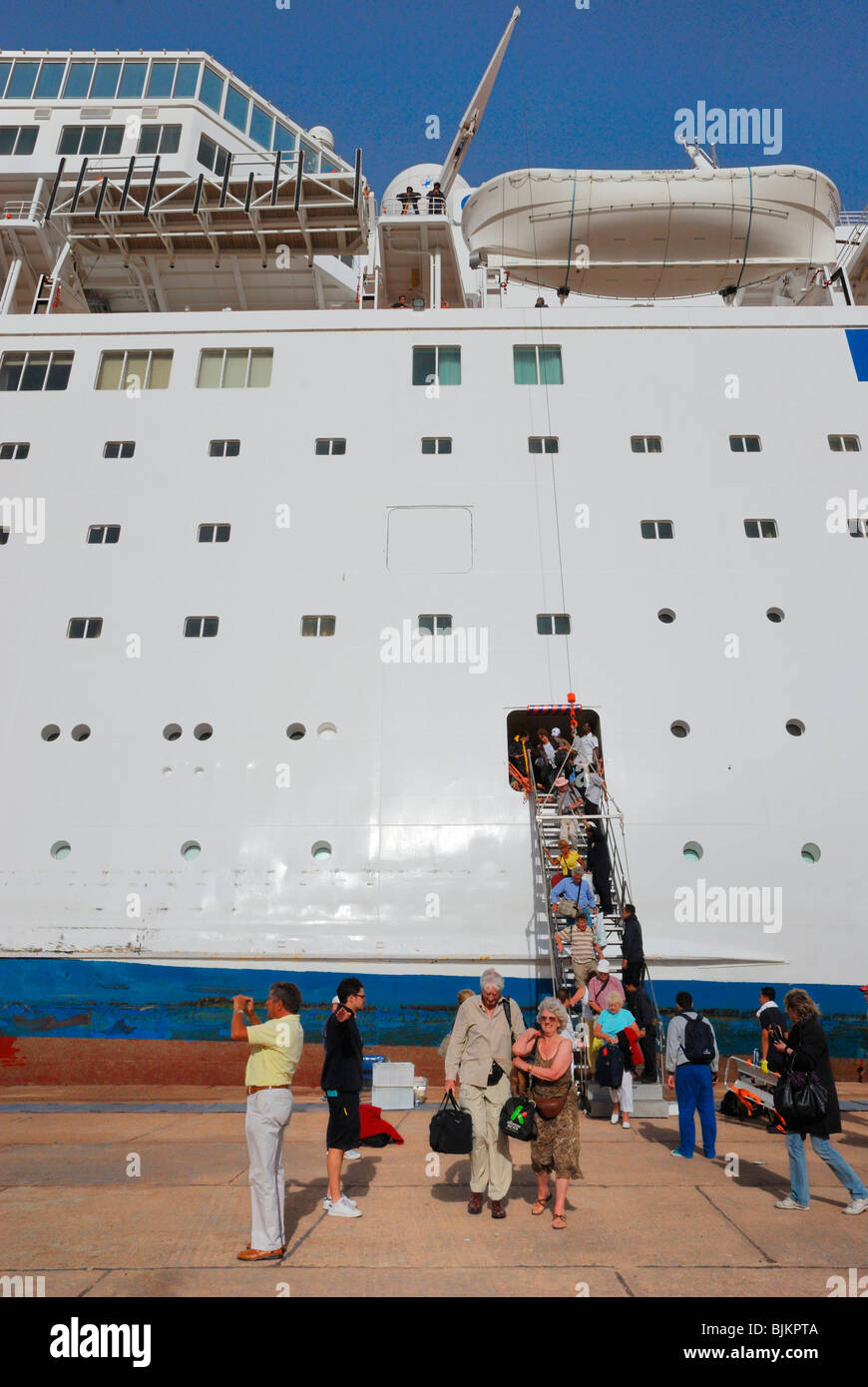 Listing COSTA EUROPA cruise ship after crashing into the quay, evacuation of the passengers, pier of Sharm el Sheikh - Stock Image