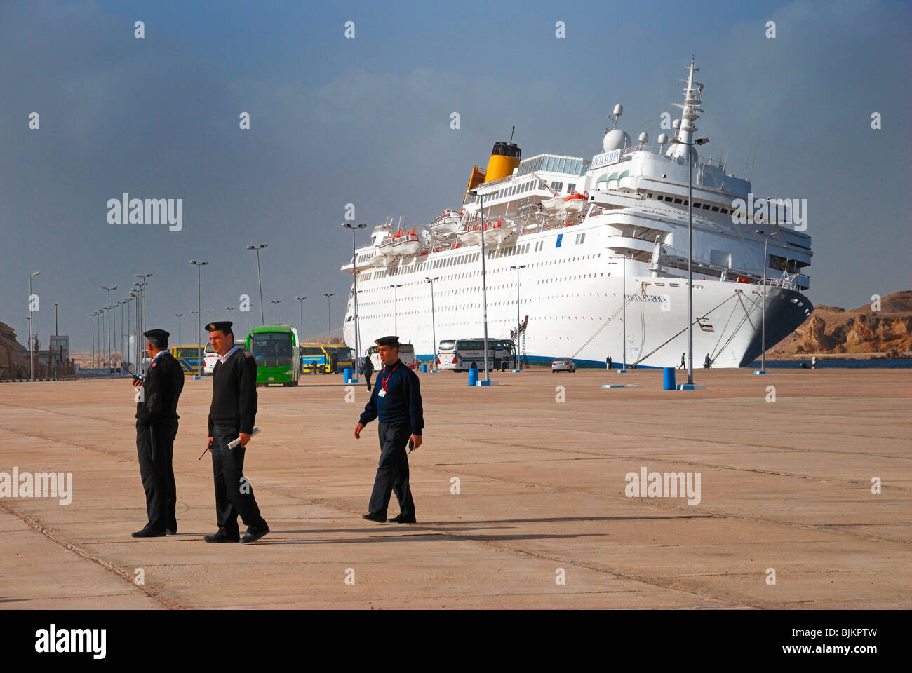 Listing COSTA EUROPA cruise ship after crashing into the quay, Egyptian officials in uniform, pier of Sharm el Sheikh - Stock Image