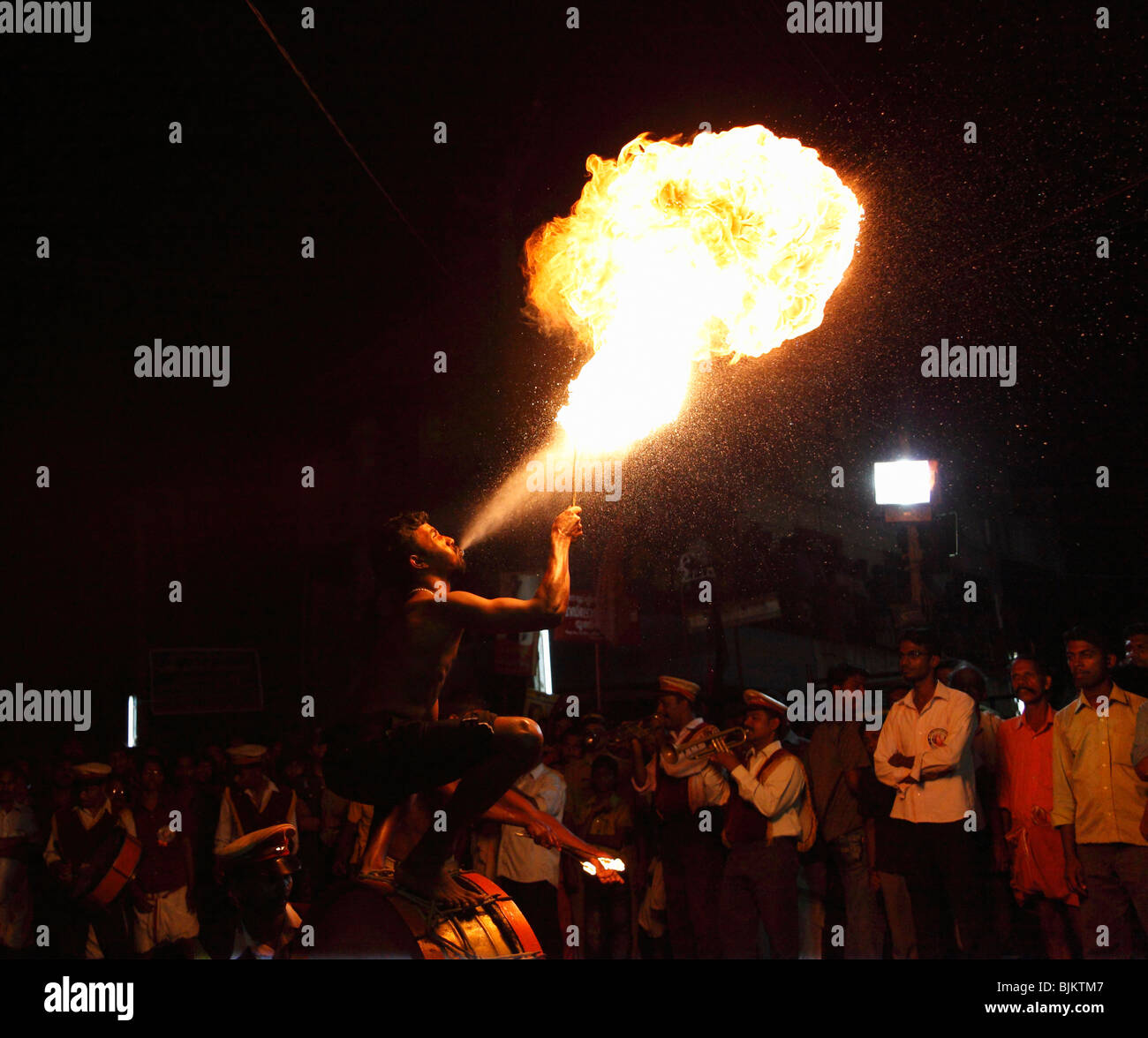 Fire eater, fire-breather, temple festival in Pulinkudi, Kerala state, India, Asia - Stock Image