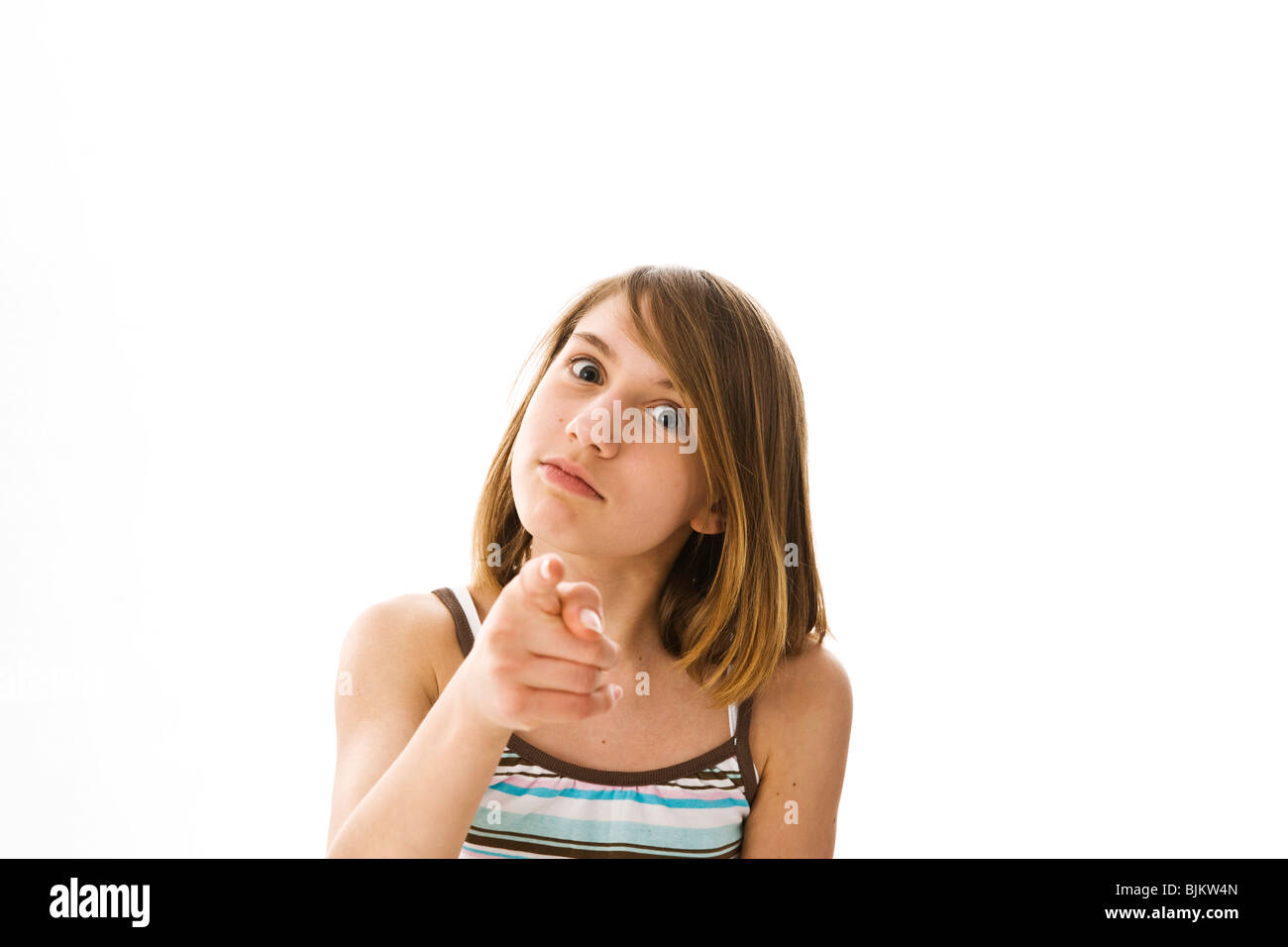 A girl seriously pointing foward with her index finger Stock Photo