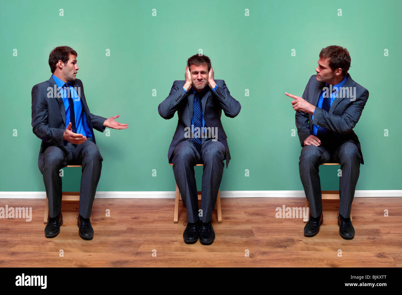 Concept image of a businessman having an argument with himself - Stock Image