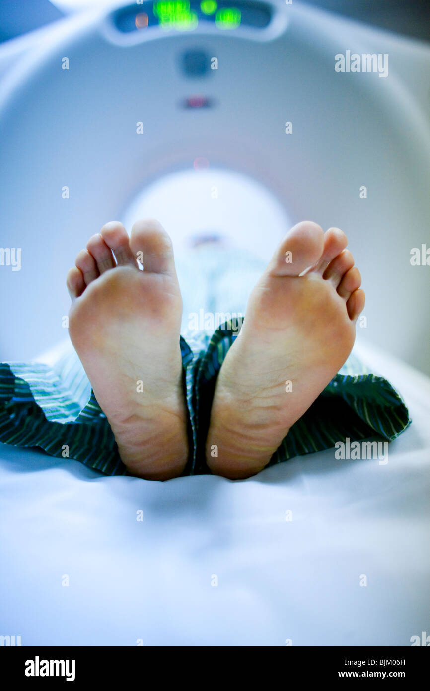 Closeup of woman's feet on diagnostic bed - Stock Image