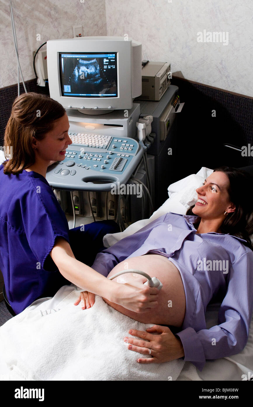 Pregnant woman having an ultrasound - Stock Image