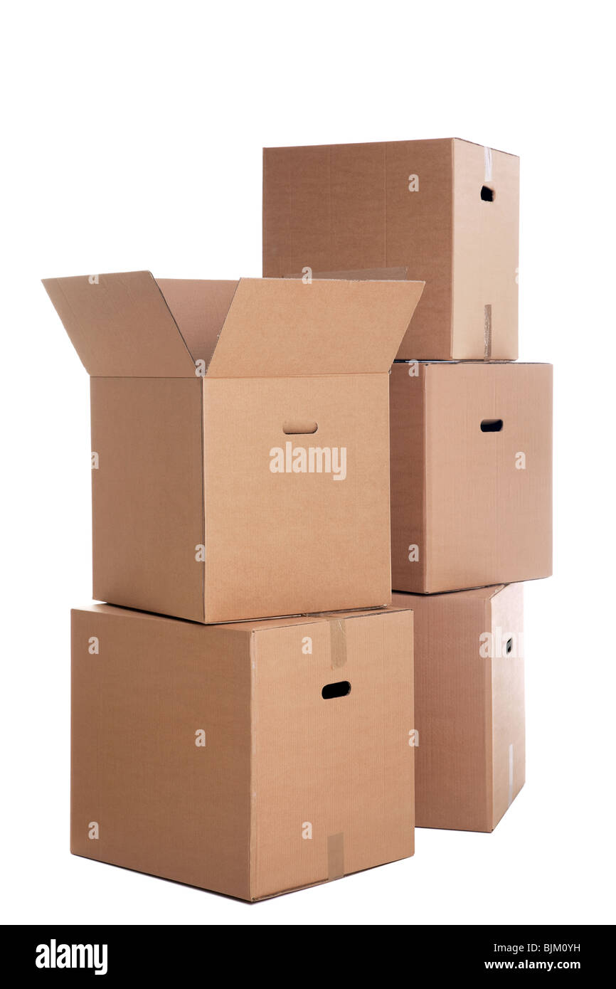 A stack of cardboard boxes isolated on a white background. - Stock Image