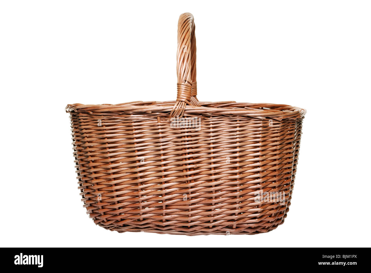 Traditional wicker shopping basket weaved from willow, isolated on a white background. - Stock Image