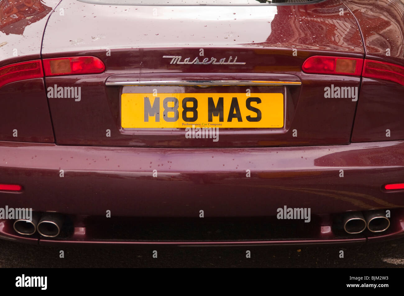 The back of a Maserati sports car with personalised number plate in the Uk - Stock Image